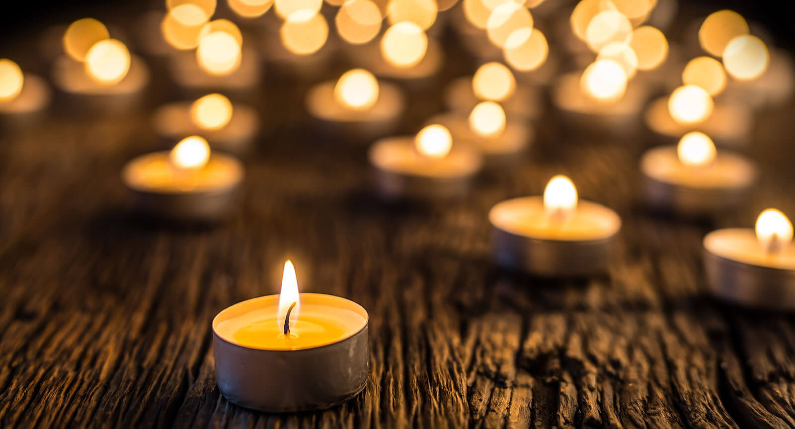 Candles on a wooden plank image