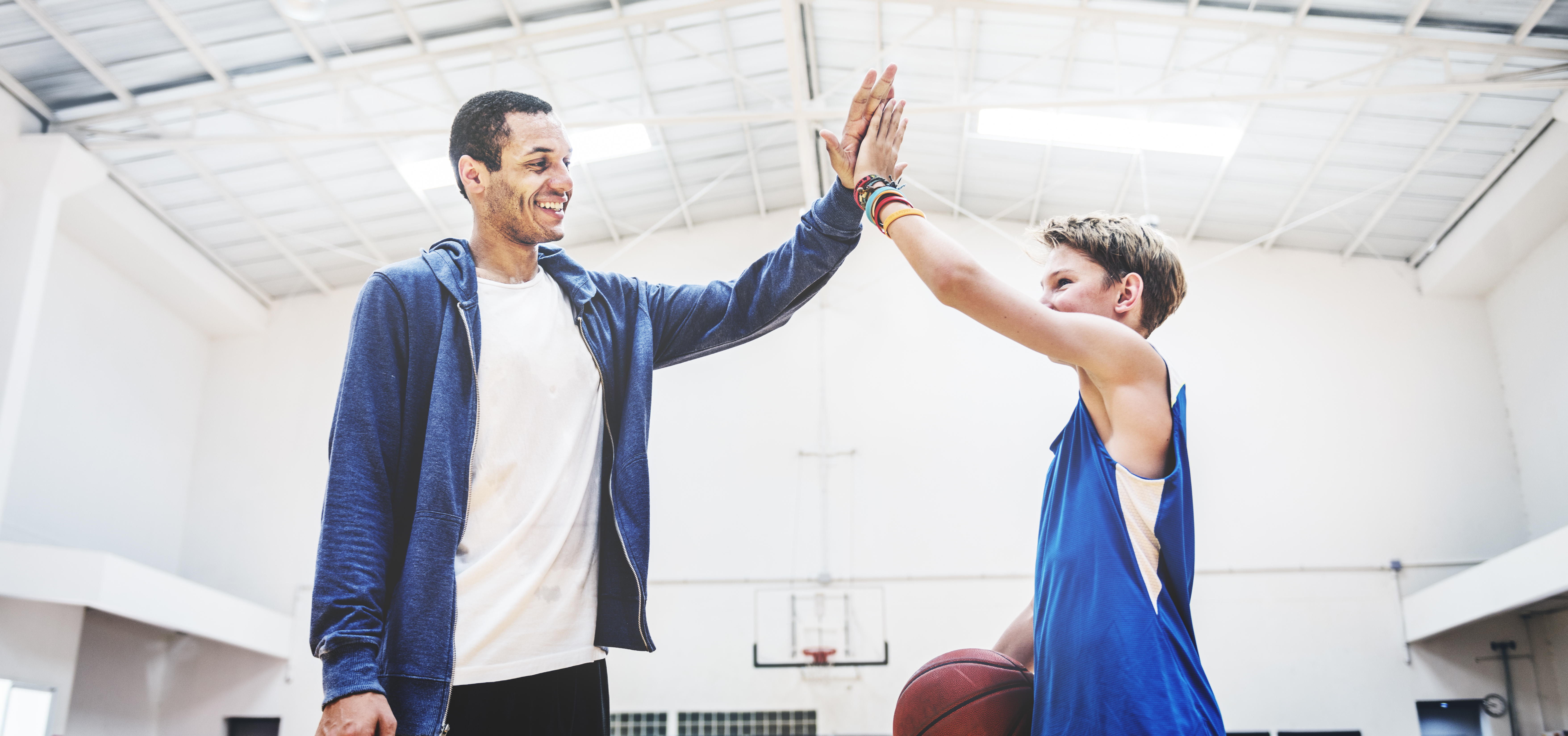 Coach and player high-five