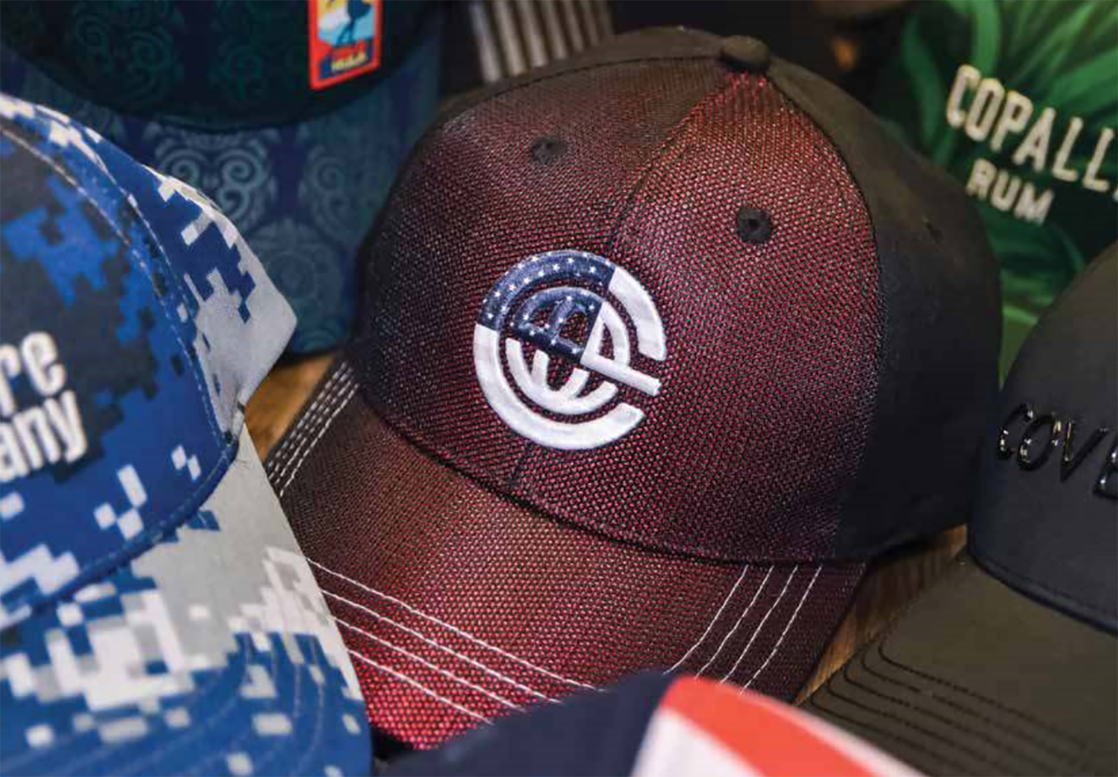 Featured image for custom cap blog post showing multiple hats in various colors and decoration options.