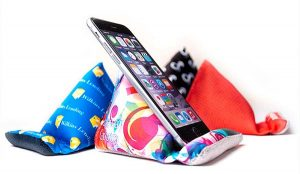 Multi-colored Desk Wedge holding a cell phone