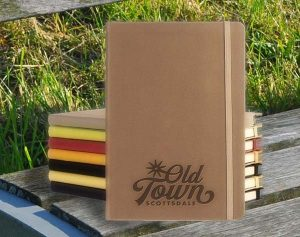 Brown Appeel Journal with other colored journals stacked behind it