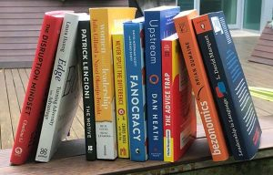 Shelf with business books leaning against each other